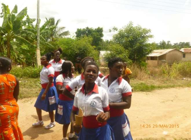 Young girls from the training center wearing French flag colored uniforms