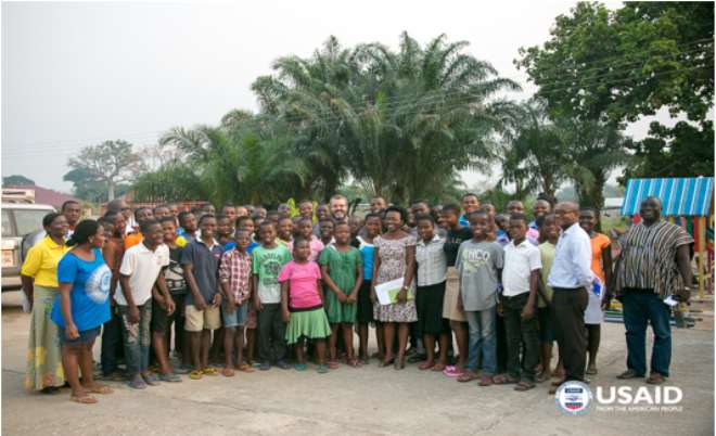 USAID/Ghana Mission Director Andrew Karas with residents of the Madamfo Shelter.