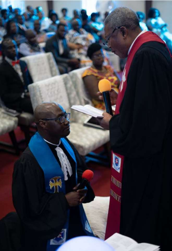 Rev. James Kumi-duodu, The Chairperson Of North America Australia Performing The Act Of Induction For Rev. Sam Okyere-mireku, Washington Dc District Minister 2