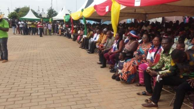 The President of the Republic of Ghana addressing the gathering whilst audience is seated at the programme