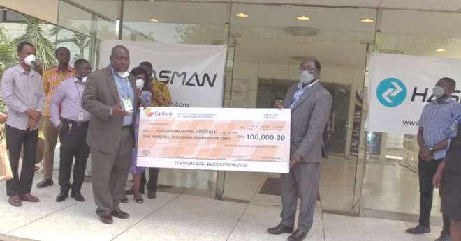 49202012508-1h830n4ayu-from-left-mr-william-andoh-wood-md-hasman-technical-services-presenting-the-cheque-to-professor-annan-director-noguchi-memorial-institute-3