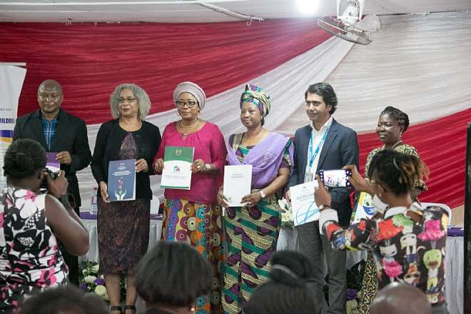 The  Minister for Gender, Children and Social Protection, Cynthia Morrison in a group photo with representatives from USAID, UNICEF and directors of the ministry.