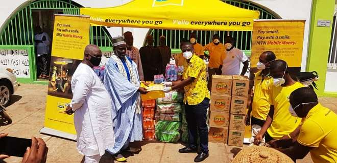 520202030438-l5gsk8v331-mr-obed-adu-amankwah-area-sales-manager-for-mtn-presenting-donated-items-to-sheikh-abdul-salam-ahmed-northern-regional-chief-imam