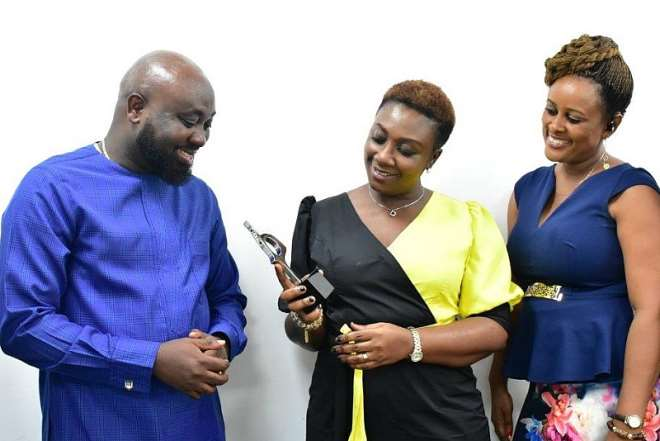 Georgina Asare Fiagbenu Corporate Communications Senior Manager, Efua Falconer, Manager Corporate Communications And Clarence Amoatey, Gm Touchpoint Magna Carta Admiring The Award