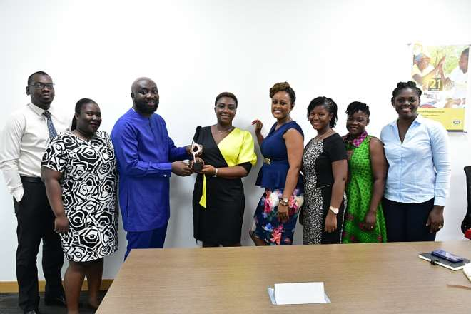 Mtn Ghana Corporate Communications Team And Reps Of Touchpoint Magna Carta In A Pose With The Award