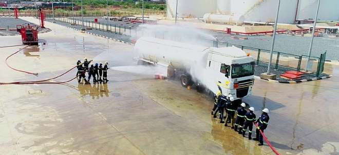 The Team Using Emergency Hydration Systems To Cool Down The Truck During The Exercise