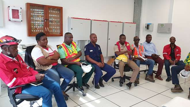 A Section Of The State Agencies That Participated In The Drill During A Debrief Session