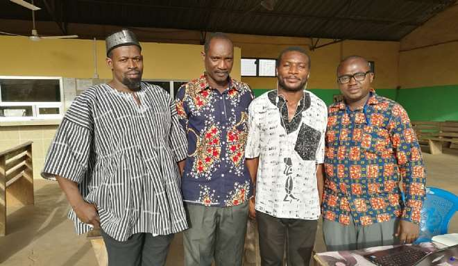 725201971940-1h830n4aau-justin-second-from-right-with-some-community-leaders