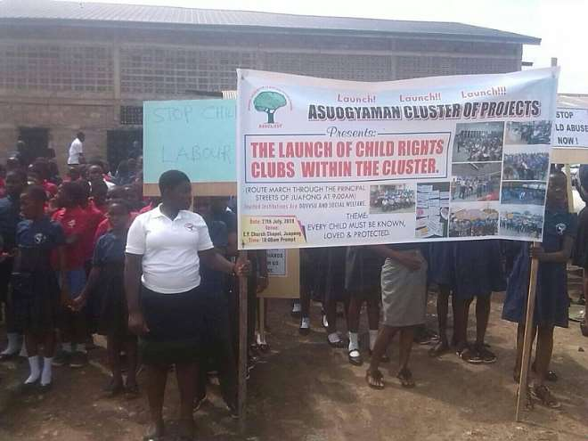 731201970952-wbrevihuto-a-group-of-beneficiary-children-prior-to-a-float