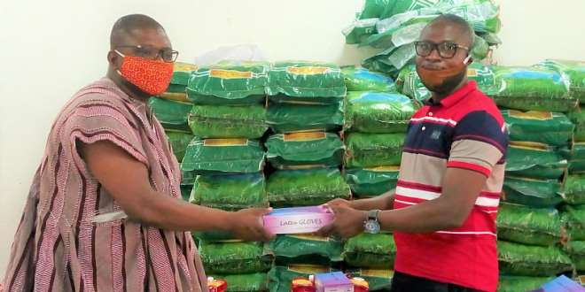 73202071459-0f728m3xxs-the-programme-manager-tree-aid-ghana-handing-over-the-relief-to-the-builsa-south-dce