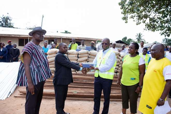 Mr. Ben Hassan Ouattara (right) Presenting The Building Materials To The Headmaster Of Brengo Presby Basic For The Reconstruction Of Dilapidated Classroom Blocks