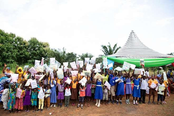 Some School Children In Hiamankyene Community Displaying Their Books After The Donation By Vivo Energy Ghana