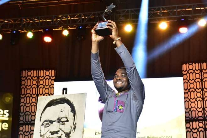 819201981447-h41o2s6fey-ultimate-winner-of-mtn-heroes-of-change-charles-ofori-antipem-displaying-the-plaque-presented-to-him