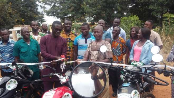 Picture on extreme left indicates the motorbikes whilst MCE for Tano South handling the motorbikes to the Municipal Agric Director