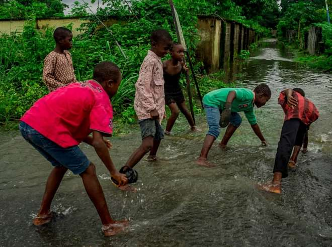 83201924048-0g730m4yxt-some-young-men-in-orsu-obodo-attempting-to-catch-fishes-around-their-homes-submerged-by-water