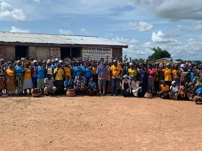The President of the African Market Baskets of the Overseas Connection of USA , Mr Steven Karowe  and CEO of Paku Ghana  Enterprise , Mr. Paul Akurugu in group picture with some of the  beneficiaries weaving