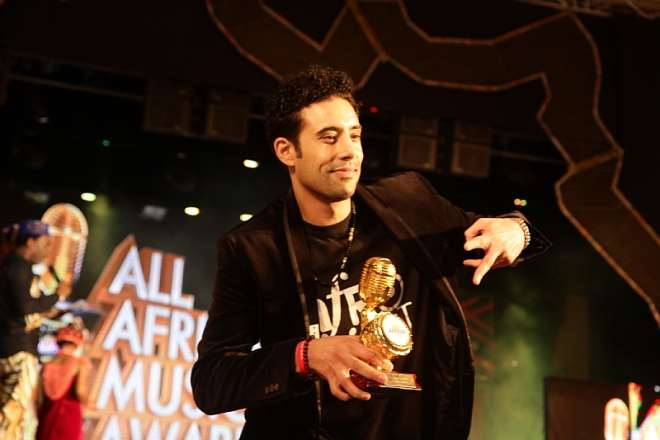 AHMED SOULTAN WITH HIS TROPHY AT AFRIMA 2014