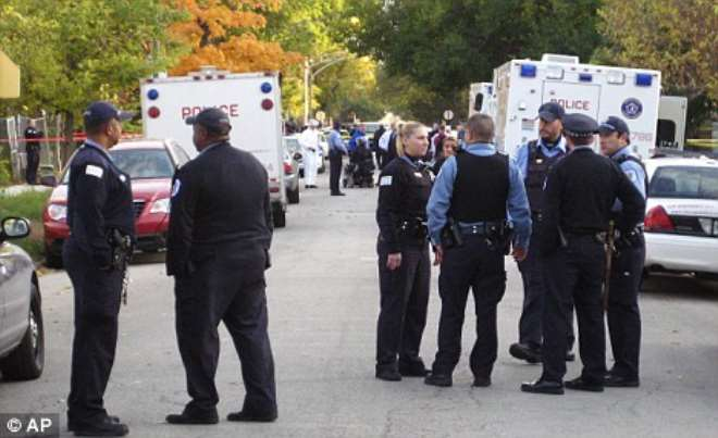 Murder scene: Police outside the house in Chicago where the bodies were found