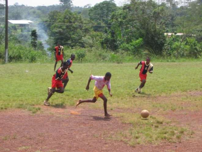 boys from akropong school for the blind playing      football