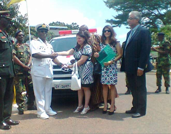 The CDS Receiving The Keys To The Ambulance From Madam Rani Melwani Of Melcom