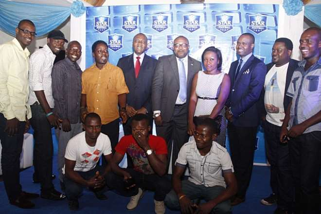 HUMAN RESOURCES, VICTOR FAMUYIBO, CORPORATE AFFAIRS ADVISER, KUFRE EKANEM, MARKETING MANAGER, STAR, GOLDBERG & EXPORT, TOKUNBO ADODO WITH THE 11 LUCKY WINNERS