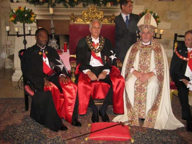 (L-R), His Majesty King Adamtey I of Ghana; His Supreme Highness Baron Nicholas Papanicoalou; and Bishop Timothy Holley, members of the Ecumenical Order of St. John of Jerusalem, Knights of Malta.