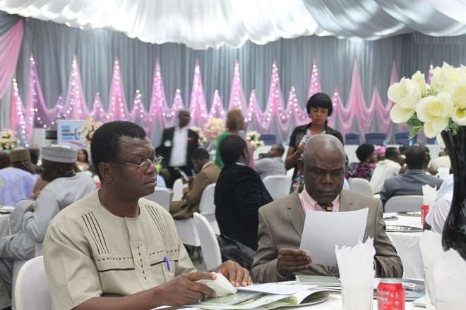 Ogu and Ahiaogu examining some documents at the event