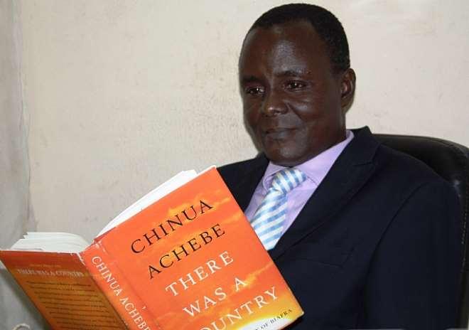 Ugochukwu Ejinkeonye with the book,