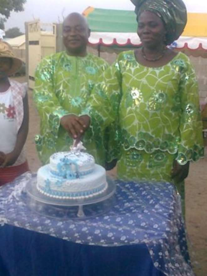 CHIEF & MRS EZE C. EZE CUTTING THEIR 20TH WEDDING ANNIVERSARY CAKE.1
