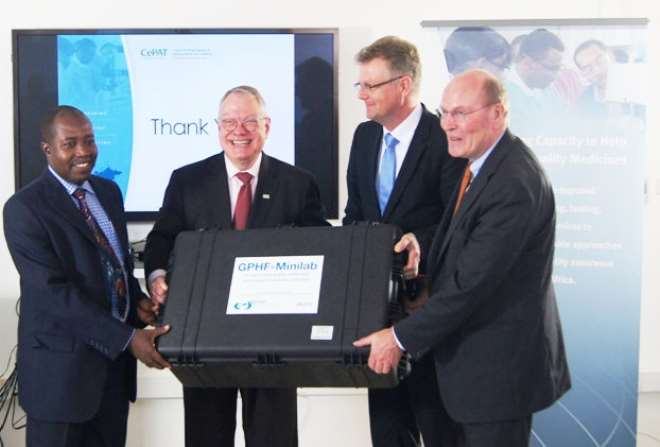 Handover Of The First Minilab In The GPFH - CePAT Alliance / From left to right: Kwesi Boateng (Country Manager CePAT), Michael Maves (Vice President USP), Frank Gotthardt (Chairman Of The GPHF And Head Of Public Affairs Of Merck) And Frank Stangenberg-Haverkamp (Chairman Of The Executive Board Of E. Merck KG)