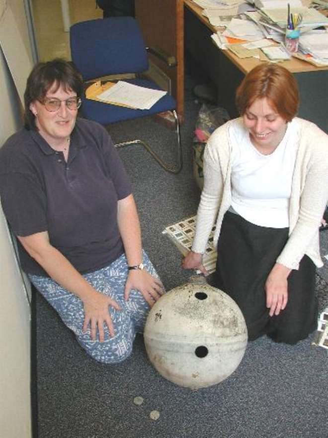 Dr.Monica Grady and Dr.Sara Russell in the Mineralogy Department of the NHM.The sample
