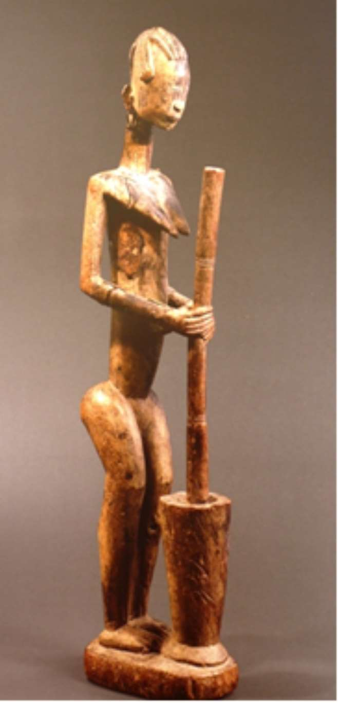 WOMAN POUNDING MILLET, BANDIAGARA, MALI, NOW IN A PRIVATE COLLECTION, PARIS, FRANCE.