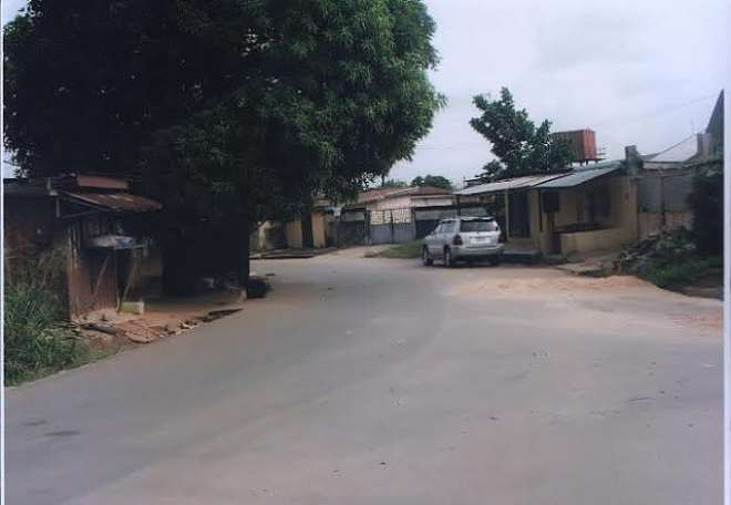 ROAD REHABILITATED BY IMO SPEAKER'S COMPANY (WERDIS LTD) AND LOCATED AT OPPOSITE ST. PETERS ANG CHURCH IKENEGBU LAYOUT BY FANO HOTELS