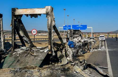 Protestors burnt trucks on the main road between the city port  Durban in KwaZulu-Natal and South Africa's industrial heartland. - Source: Photo by Darren Stewart/Gallo Images via Getty Images