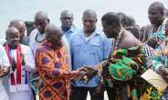 President Akufo-Addo, left, in a handshake with a chief from Ningo-Prampram