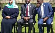 African Court Present flanked on his left by the African Court Vice President and on his right by Vice President of Tanzanian