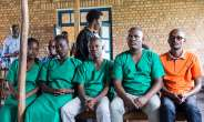 Four journalists from Burundian news outlet Iwacu (from left) Agnes Ndirubusa, Christine Kamikazi, Terence Mpozenzi, and Egide Harerimana--and their driver Adolphe Masabarakiza--appear at the High Court in Bubanza, western Burundi, on December 30, 2019, charged with undermining state security. (AFP/Tchandrou Nitanga)