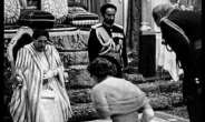 Queen Elizabeth and Prince Phillip bowing before the real original African Royalty