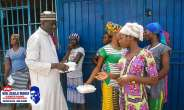 Alhaji Manaf ,distributing food to the female head porters