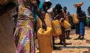 Scenes from the Labadi nighborhood of Ghana, where performers and locals participate in Serge Attukwei Clottey's Afrogallonism piece.  FRANCIS KOKOROKO/ ARTNEWS,COM