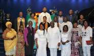 HE Papa Owusu Ankomah and His wife in a group photograph with the Clergy, Traditional rulers, as well as staff of the Ghana High Commission UK.