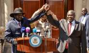 Bitter South Sudan Rivals Salva Kiir (left) and opposition leader Riek Machar (right)  at talks last year which have finally produced a new government.  By Majak Kuany, Majak Kuany (AFP)