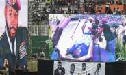 DJ Arafat's coffin was placed at the centre of the football pitch.  By ISSOUF SANOGO (AFP)