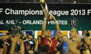 Egypt legend Wael Gomaa lifts the CAF Champions League trophy after Al Ahly won the 2013 final.  By GIANLUIGI GUERCIA (AFP)