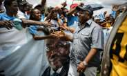 Gabon President Ali Bongo greets supporters in Moanda ahead of presidential elections.  By Marco Longari (AFP)