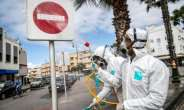 Health ministry workers (pictured March 22, 2020) disinfect the streets of Rabat, the capital of Morocco, where the government has approved the use of hydroxychloroquine to treat the coronavirus.  By FADEL SENNA (AFP/File)