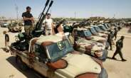 In this photo taken on June 18, 2020, pro-Haftar forces gather in the eastern city of Benghazi, reportedly on their way to back up fighters near the city of Sirte.  By Abdullah DOMA (AFP/File)