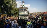 Kolisi stands proud on board the victory bus in Soweto.  By Michele Spatari (AFP)