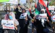 Libyans chant slogans during a demonstration over poor public services at Martyrs' Square in Tripoli on August 25, 2020.  By - (AFP)