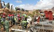 Moroccan rescuers search for bodies after floods overturned a bus on September 8 in the kingdom's southeast.  By - (AFP)